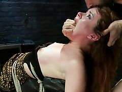 redhead sex slave gets a dick on her forehead
