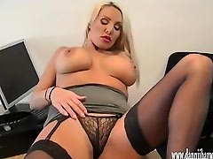 Horny blonde secretary teasing in silk and nylon and rubbing her clit