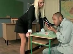Teacher and her black student enjoying footsex