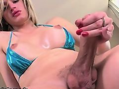 Tgirl Nanda fills her ass with dildo toy