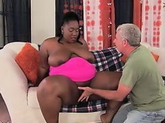 Horny black plumper takes her fuck buddy's fat dick in her