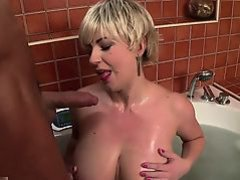 Sandra Boobies is soaking in the tub when her boyfriend...