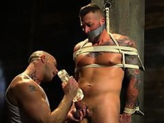Inked BDSM hunk gets dick seduced with toy