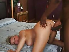 Cougar with big tits fucks african cock