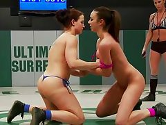 two naked brunettes fighting a kinky fight