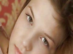 Petite 18yearold girl teasing herself on sofa