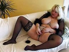 Chubby MILF with biggest tits dildoing
