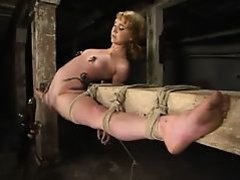 Blond in overextended bondage